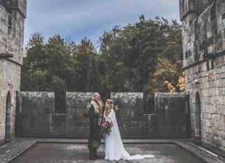 Couple on the battlements of Langley Castle Hotel, Northumberland